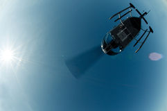 Helicopter flying over camera Stock Photos