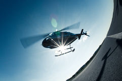 Helicopter flying over camera Royalty Free Stock Photos