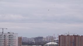 Helicopter flying over city skyline stock footage