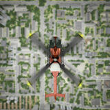 Helicopter is flying over the city Royalty Free Stock Images
