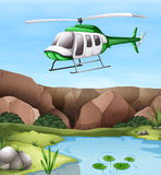 Helicopter flying over the cliff Royalty Free Stock Photos