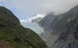 Helicopter flying over Franz Josef glacier Royalty Free Stock Images