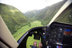 Helicopter flying over Hawaii. Cockpit of helicopter flying over green valley on island of Hawaii, U.S.A Stock Images