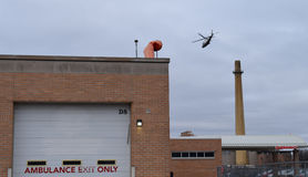 Helicopter Flying Over Hospital Emergency Sign And Ambulance Onl Stock Photos