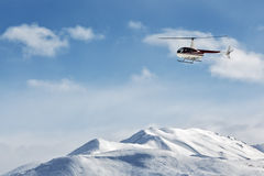 Helicopter flying over the mountains on the Kamchatka. Russia, Far East Stock Photos