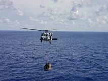 Helicopter Flying Over the Ocean. royalty free stock image