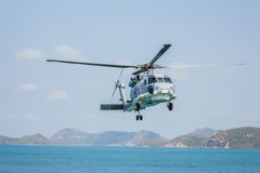 Helicopter flying over the sea Stock Photo