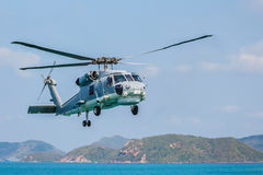 Helicopter flying over the sea Royalty Free Stock Photography