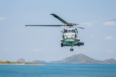 Helicopter flying over the sea Royalty Free Stock Photos