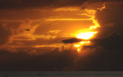 Helicopter flying at sunset Stock Photography
