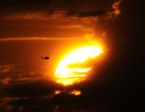 Helicopter flying at sunset Royalty Free Stock Image