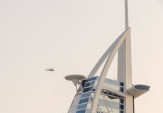 Helicopter flying to Burj Al Arab hotel Royalty Free Stock Photography