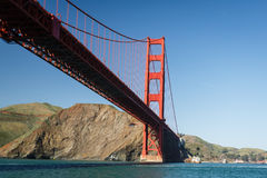 Helicopter flying under the Golden Gate Bridge Royalty Free Stock Photo