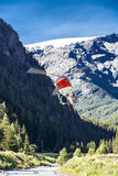 Helicopter flying through a valley, Monterosa Royalty Free Stock Photo