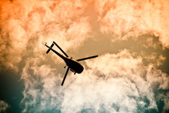 Helicopter flyling in the air. Chopper flying in the air on a sunny and cloudy day Royalty Free Stock Photography