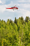 Helicopter in forest Stock Photography
