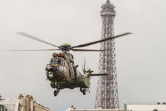 A helicopter in front of the Eiffel Tower for the Bastille Day in Paris - Un hélicoptère pour le 14 Juillet à Paris Royalty Free Stock Photography