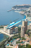 Helicopter in front of the skyline of Monaco. Helicopter flying away with in the background the skyline of Monaco stock photo