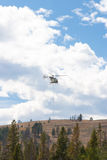 Helicopter full of Smokejumpers fight forest fire in Yellowstone Stock Photo