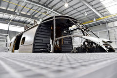 Helicopter fuselage in a factory Stock Photography