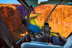 Helicopter on Grand Canyon. Helicopter cockpit with pilot arm and control console inside the cabin on the Grand Canyon Lake Powell. Reserve on the Colorado River royalty free stock photography