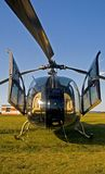 Helicopter on green grass. Front view Stock Photos