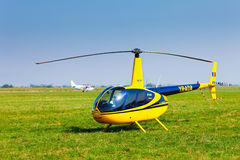 Helicopter on a green grass field preparing to take off Stock Photos