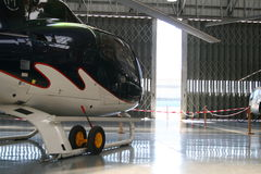 Helicopter hangar. Inside an helicopter hangar with doors opened royalty free stock photo