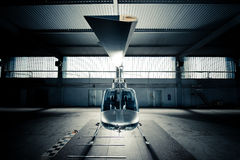Helicopter in hangar Stock Images