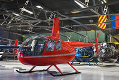 Helicopter Hangar, Full of Robinson R44. Helicopter charter business, hangar full of Robinson R44, and Bell 407's in the background Stock Image