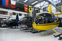 Helicopter Hangar, Full of Robinson R44. Row of Robinson R44 parked inside a hangar Royalty Free Stock Photo