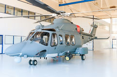 Helicopter in hangar. Military grey  helicopters in hangar Royalty Free Stock Photo