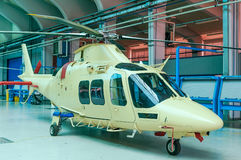 Helicopter in hangar. Helicopter yellow parked  in hangar Stock Image