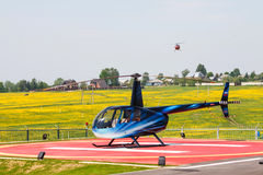 Helicopter on helipad Stock Photography