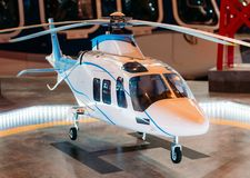 The helicopter on the helipad with a light beacon lights on the platform. Stock Photo