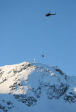 Helicopter Hoist Peak. A mountain rescue team prepares for a helicopter rescue Stock Images