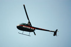 Helicopter hovering in the air Stock Image