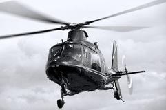 Helicopter hovering in flight Stock Photo