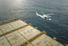 Helicopter hovering over the deck of a ship. Royalty Free Stock Photography