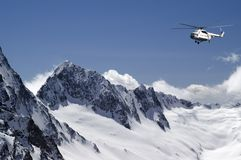 Helicopter In High Mountains Royalty Free Stock Photography