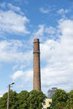 Helicopter and industrial chimney Royalty Free Stock Photo