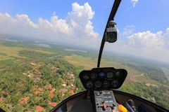 Helicopter Robinson R44. Helicopter view inside the cabin flies in Sri Lanka Royalty Free Stock Images
