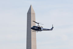 Helicopter inspects Washington Monument Royalty Free Stock Photos