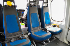 Helicopter interior and seat for passenger, seat and safety belt in interior of helicopter Stock Photo