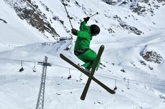 Helicopter jump. A Tele-hele. A skier executes a perfect crossed skis tele-heli during a high jump Royalty Free Stock Photos
