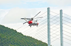 Helicopter and Kessock Bridge. Royalty Free Stock Photo