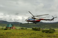 Helicopter landed in the Uzon Caldera. Stock Photo