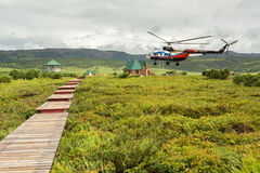 Helicopter landed in the Uzon Caldera. Stock Images