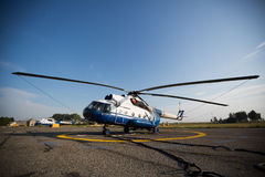Helicopter landing in the airport. Helicopter parked on runway airport Royalty Free Stock Photo