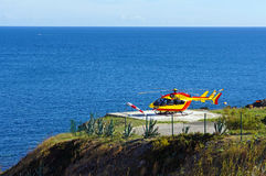 Helicopter on a landing area with sea in background Stock Photography